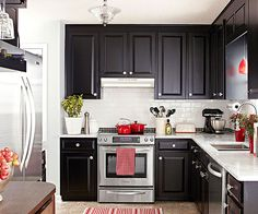 Black cabinets with white walls and red accents