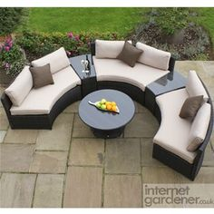 Maze Rattan Half Moon Curved Garden Sofa Set can be used as shown or with the sofas all together and the tables at the end.