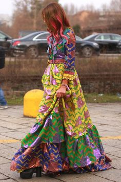 Anna Dello Russo headed to the Gucci show in a dress by the designer during Milan Fashion Week. (Photo: Craig Arend for The New York Times)