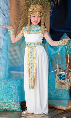The beauty and splendor of ancient Egypt are well represented in this enchanting Cleopatra Halloween costume. Your child will rule Halloween in this quality outfit which features the Egyptian style white dress with gold and blue collar and belt, an attached blue cape, as well as gold and blue wrist cuffs. The eye catching gold headpiece completes the look of a true Queen of the Nile.