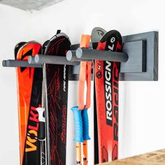 Get your skis off the floor and onto the wall with this easy to make garage ski rack! Customize this DIY ski rack to fit all your gear behind the door! Garage Shelving, Garage Storage, Storage Rack, Woodworking Plans, Woodworking Projects, Industrial Computer Desk, How To Clean Aluminum, Brass Coat Hooks, Silver Spray Paint