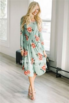 This dress is everything you've been looking for and would be perfect for Easter Sunday, church or a day out! The cutest mint color, this dress has long sleeves, an elastic waist a pretty pink floral print and cute front pockets.