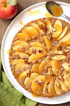 This beautiful yet easy Caramel Apple Pecan Tart is actually an apple cake with pecans all dressed up in a tart pan. No need to make a pie crust; all you need to do is pour cake batter into the pan and top with apples.