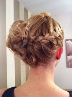 Cool braid updo... I have an urge to grow my hair out. But im sure it will pass...