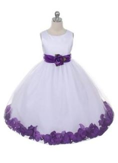 Beautiful flower girl dress in white or ivory . Bridal satin bodice. Skirt is done in layers of tulle with pocket for the petals. Dress is fully lined with a sewn in crinoline netting for a fuller look. Customize it with the colours you need for your special occasion.