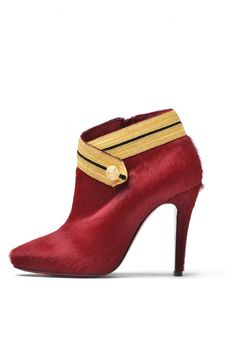 Crimson ponyhair ankle boot with gold epaulet by Christian Louboutin.