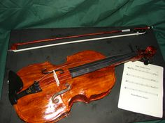"""16"""" Viola - I wanted to give my son a meaningful """"wow"""" cake for his 15th birthday. I chose the Viola since it's his instrument of choice in Advanced Orchestra. Everything is edible, even the strings. It's a Red Velvet Key Lime cake with IMBC."""