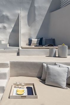 Porto Fira Suites situated on a privileged location, in Santorini island, on Fira's Caldera cliffs, with magnificent views of the volcano, the deep blue of the sea and the most famous sunset from your private balcony.