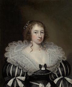 Janssens van Ceulen Portrait of a lady, bust-length, in a black-and-white dress with a lace collar, with a pearl necklace, earrings and ribbons in her hair