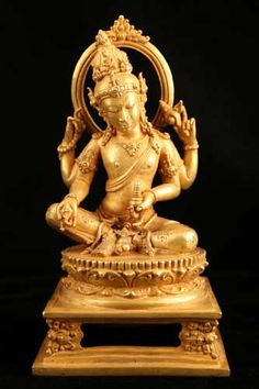 Image from http://www.antiques.com/vendor_item_images/ori__1082372102_1071351_Gold_Sculpture_of_Four-Armed_Hindu_Deity_-_CK.0593.jpg.