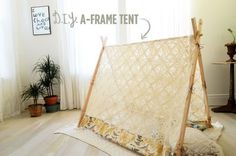 bellalumina:    (via Make Your Own A-Frame Tent - A Beautiful Mess)  A bit of work, but really sweet… I would have loved a tent like this in a corner when I was young and reading ALL THE TIME…    I love how you can see through this tent, but it still creates a sense of space. What a great use of vintage (or 2nd-hand) fabric.