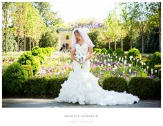 Beautiful bridal portrait at the Dallas Arboretum Botanical Gardens and wedding in front of the tulips and waterfall by Dallas wedding photographer that is an award winning wedding photographer in Dallas, Fort Worth, TX and nationwide for destination weddings