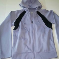 """Reebok Hooded Jogging Track Suit Jacket - Sz L Reebok Play-Dry Hooded Track Jacket. Lined in Cozy Fleece. Color: Dusty Lavender and Black. Size: Large. Long Sleeves. Drawstring Hood. Two Pockets at Waist. Interior Zippered Pocket. Polyester. Machine Wash. No Stains, Holes or Other Issues Noted.  Depending on lighting this sometimes looks more gray than purple and vice versa.  Measurements 45"""" Underarm to Underarm - doubled 34"""" Waist - doubled 23-1/2"""" Length Reebok Jackets & Coats"""