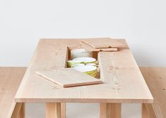 Max Lamb created a collection of wooden shelves, tables and benches with concealed storage for UK furniture brand Benchmark.
