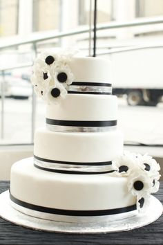 White, silver and black themed wedding cake: http://www.stylemepretty.com/2012/02/02/lincoln-center-wedding-photo-shoot-by-bellafare-jen-huang/   Photography: Jen Huang - http://jenhuangphoto.com/