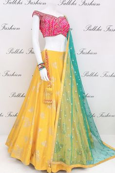 palkhi fashion presents designer lehenga choli featuring a yellow lehenga done up in silver foil motifs.Off shoulder designer blouse done in pure bandhani design with contrasting teal dupatta with elegant work on ii Call/WhatsApp for Purchase Inqury : Indian Fashion Dresses, Indian Gowns Dresses, Dress Indian Style, Indian Designer Outfits, Indian Outfits, Half Saree Designs, Choli Designs, Lehenga Designs, Indian Lehenga