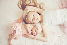 Big sister, little sister, newborn stylized photo session, natural light, indoors, siblings with baby