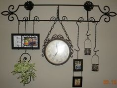 plate rack turned sideways with collections hanginggotta like it & I LOVE the plate holder doubled as a frame holder. Wonderful ...