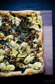 This Spinach, Artichoke and Caramelized Leek Tart is a delicious and flavorful appetizer. Get this easy to follow recipe from Savory Simple!