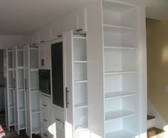 Row of pull out pantries. perfect for dead space in kitchen.