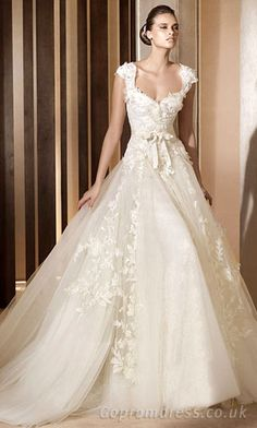 online wedding dresses, cheap wedding dresses. I like this one, though it's too puffy for my taste.