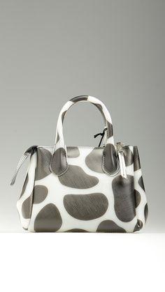 Giraffe print pvc crossbody bag in black and white featuring top zip, tote handles, adjustable crossbody strap, silver hardware, 9'' x 5.1'' x 7.8'', 100% pvc.