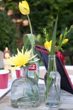 clear vases and coke bottles as centerpieces  #picnicchic