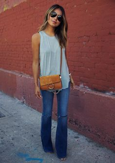 Love this style of jeans, length of shirt AND bag. I'd pair a little cardi with it.
