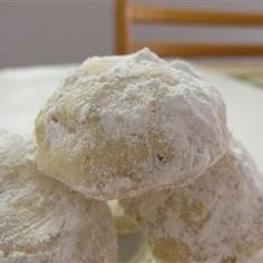 Cream the butter with 1/2 cup of the confectioners' sugar and the vanilla. Mix in the flour, nuts and salt. Roll about 1 tablespoon or so of dough into balls and place on an ungreased cookie sheet.