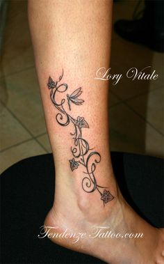 Butterfly and flower foot tattoo by travis allen twisted for Immagini tatuaggi piede