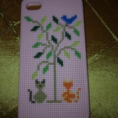 I love this! This is close to my Piffcat Pillows iPhone cross stitch case I want to make!