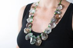 Incredible Necklace of 18 Faceted Quartz Crystals with Fascinating Inclusions Incredible  Necklace of 18 graduated chunks of Faceted, Facinating Quartz Crystals Filled with Green Lodalite and other colored Inclusions.  This oh, so unusual necklace is a one of a kind.  19 Inches in length. A$3265 Dec2016