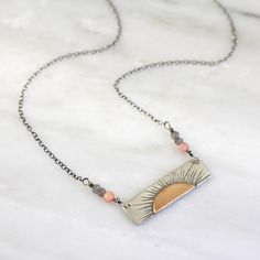 Still I Rise Bronze And Silver Bar Necklace – Sarah DeAngelo Silver Bar Necklace, Tassel Necklace, Arrow Necklace, Still I Rise, Be Still, Silver Bars, Grey Stone, Shades Of Green, Red And Pink