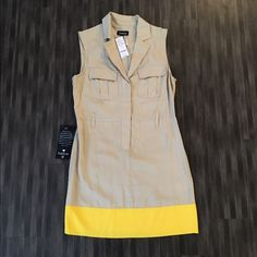 "Bebe short sleeve dress Short sleeve ""safari"" dress. Tan with yellow bottom. Great for the spring and summer. 100% Lyocell. Machine wash cold. bebe Dresses"