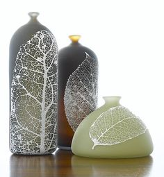 """""""Nick Chase's bottles are beautifully proportioned, and provide excellent broad surfaces for his application of delicate but graphically strong patterns of leaves. Note the soft warm interior glow that warmly contrasts winter's frosty exterior imagery."""" - Michael Monroe (shown: Leaf Bottles by Nick Chase)"""
