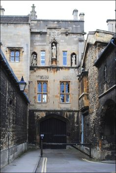 """The rear entrance to New College is in New College Lane, Oxford. The lane is largely surrounded by high stone walls with few windows. Despite its name, New College is one of the oldest of the Oxford colleges, having originally been founded in 1379. The second college in Oxford to be dedicated to the Blessed Virgin Mary, it was founded by William of Wykeham, Bishop of Winchester as """"The College of St Mary of Winchester in Oxford"""". New College was originally established for the educat..."""
