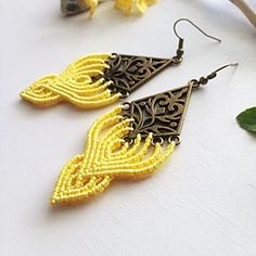 A personal favorite from my Etsy shop https://www.etsy.com/listing/556268907/macrame-earrings-diy-yellow-macrame
