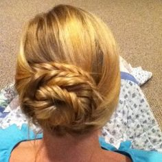 karens hair i did this weekend. fish tail pig tail braids wrapped into a bun.
