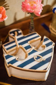 Navy & gold striped anchor wedding cake!   Hunter Ryan Photo