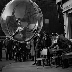 """Women in Bubbles over Paris, is a series of photographs made by Melvin Sokolsky in 1963 for Harper's Bazaar """"Bubble"""" Spring Collection"""