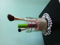 DIY makeup and brush storage using sand...works great for a beach themed room!
