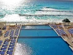 Great Parnassus Resort & Spa. The all inclusive family hotel in Cancun, Mexico! View of our infinity pool and beach.
