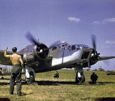 RAF Bristol Blenheim A mechanic signals for take-off to an Allied pilot before a raid over Occupied France, England, 1941 photo by Robert Cappa Navy Aircraft, Ww2 Aircraft, Military Aircraft, Aircraft Images, Bristol Blenheim, Aviation World, Ww2 Planes, Battle Of Britain, Royal Air Force