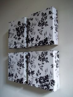 cereal boxes covered in scrapbook paper. . . super inexpensive because they have no frames....easy to hang on the wall too :)