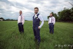 I like that the groom is wearing a vest, and the men are wearing suspenders. Purple, sage and grey?