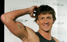 Olympic medalist Ryan Lochte shows off his Olympic rings tattoo