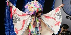 Karen O, frontwoman of the Yeah Yeah Yeahs, ays she loves pushing the limits of fashion and what she wears on stage is just as important as preparing her set. ~ BBC #KarenO #YeahYeahYeahs #headdress