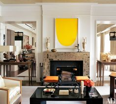 In the living room, a 1962 Ellsworth Kelly painting surmounts the custom-made mica mantel. Diego Giacometti bronze stools join a Jean Dunand lacquer cocktail table and a Eugène Printz side table on the bespoke V'Soske rug. Armchairs in the manner of Francis Jourdain are covered in a Holly Hunt fabric.