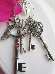 Silver Key Necklace, Alice Inspired Keeper of the Silver  Keys Necklace. Key Necklace, Skeleton Key Pendant,Lock and Key Jewelry. $25.00, via Etsy.