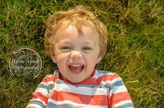 Smiling Toddler boy laying in grass in Pittsburgh PA - Kristin Merck Photography, LLC